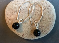 """A single glossy black onyx polished gemstone and .925 sterling silver conspire in a sleek, high-contrast, """"no-nonsense"""" earring. A pop of shine and intensity for your wardr... #trending #etsy #etsymntt"""
