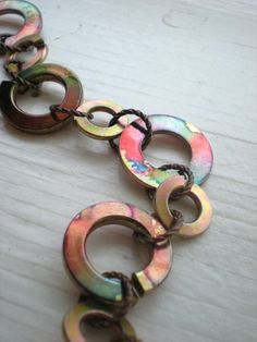 The alcohol inks are a fabulous touch on this industrial styled bracelet.