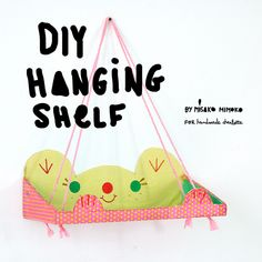Recycle a shoebox into a super cute hanging shelf for your tiny toys, books, and craft supplies!