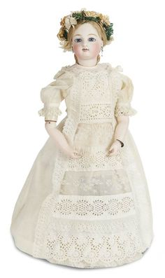 Jules Steiner,his early deposed model,when wound,the lady glides and twirls in a waltz-like and elegant manner,circa 1865. Value Points: very beautiful face on the rare early deposed poupee,mechanism functions well,wearing beautiful antique lace gown and coronet of silk flowers.