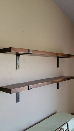 Add a modern industrial style to any room with these handmade metal shelf brackets. Each bracket is cold bent by me to assure the highest quality possible. This listing is for one shelf bracket. Steel is 1.5 wide x 3/16 thick. All brackets are handmade so there may be very slight variations. The lip of the bracket is 1 3/8 high.  ***LISTING IS FOR 1 BRACKET***  ***HARDWARE NOT INCLUDED***  *** Black lag bolts available in shop listing***  The depth of the bracket is the usable space between…