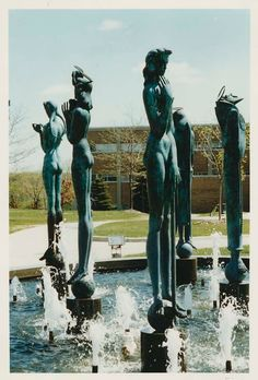 "Description of . Marshall Frederick's 'Saints and Sinners"" sculpture in fountain in front of Oakland University's Kresge Library; photo taken May 19, 1994 (File/The Oakland Press)"