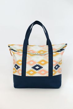 Perfect for bringing along the essentials, the Senna Tote features a fold over zipper flap opening and has a handy front pocket, a large back pocket,