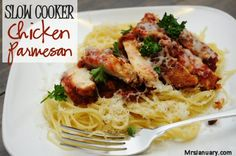This slow cooker chicken parmesan is so tasty - juicy chicken with crusty skin, melty parmesan cheese and a ton of flavor. Yum!