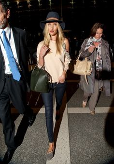 la modella mafia Rosie Huntington Whiteley in a Christopher Kane sweater and Givenchy bag