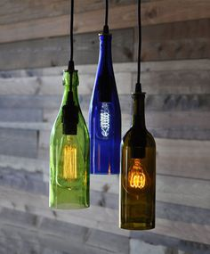 is a light chandelier made from three different recycled wine bottles - cobalt blue, green and olive colored glass. There is a variety of Old Wine Bottles, Recycled Wine Bottles, Wine Bottle Art, Lighted Wine Bottles, Diy Bottle, Bottle Lights, Wine Bottle Crafts, Empty Bottles, Altered Bottles