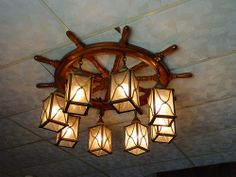 Ship wheel chandelier nautical light fixtures custom maritime ships wheel and lanterns chandelier mozeypictures Gallery