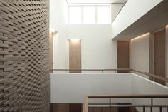 Gallery of This Hand-Laid Brick Feature Wall Was Inspired by Soundwaves in Water - 13