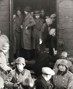Marseille sous l'occupation. Edouard Krihiff and other Jews from Marseilles being deported to the La Compiègne camp,from where they were later transferred to the Drancy camp. Marseilles, France, January 24, 1943 - Standing in the center: Edouard Krihiff - Anonymous No Longer.