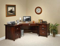 Amish Eshton Corner Desk Need an exceptional desk that will fit in the corner? You've found the finest with the Eshton. File drawers, regular drawers, writing board pullouts, dovetailed joinery and four wood types to choose from.