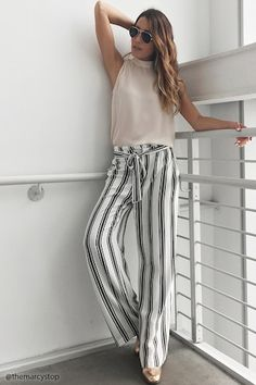 Forever 21 Contemporary - A pair of woven palazzo pants featuring an allover stripe pattern, an elasticized waist with ruffle trim, a removable self-tie sash, zip fly, hook closure, and on-seam pockets.