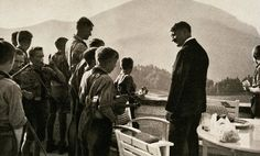 Adolf Hitler meets with members of a Hitler Youth orchestra at the Berghof, Bavaria, Germany.