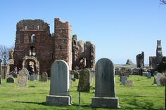 Lindisfarne Priory with Lindisfarne castle in the background; camped one night on this island... sshh