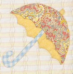 A pretty paisley umbrella - but look at the 'rain' quilting behind it. I think I could do that by hand.