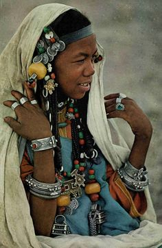Africa | National Geographic, June 1971. | A Berber woman wears her prized silver jewelry at a friend's wedding. Akka, Morocco | © Thomas J Abercrombie.