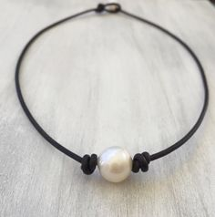 Leather pearl choker, pearl choker necklace, bridesmaid jewelry, single pearl choker, pearl on leather, pearl choker, pearl jewelry by Carolinelenox on Etsy https://www.etsy.com/listing/118262722/leather-pearl-choker-pearl-choker