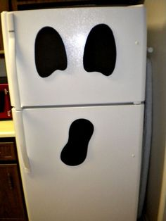 ghost fridge - such a cute idea (and tons of other cute Halloween ideas):