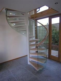 "The Skipworth Project A modern design using American White Oak treads and Handrail with a limed finish all manufactured in house and installed by our own craftsmen. The 10mm cantilevered toughened glass does add approx £3000 to the cost of an average spiral but it does give it that ""wow"" factor. This premier quality spiral staircase is available to clients requirements in any diameter for both domestic and commercial applications"