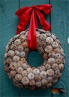 "Pinecone Wreath - chocolate taffeta/velvet, 16"" wreath by Cynthia Scott Designs. $90.00. Pinecone wreaths are a versatile choice for fall and winter outdoor decorating. Whether hung on a door or nearby wall, they can enhance your entry with classic, natural beauty. This wreath is handmade by Cynthia Scott Designs. It is available in 3 sizes: 16"", 20"" and 24"" with a choice of ribbon color for hanging. Manufacturer recommends that wreaths displayed outdoors be kept dry. Plea..."
