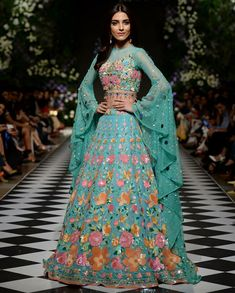 Unique patterned offbeat lehenga choli for this wedding season is being preferred over red. Choose a lehenga that makes everyone's hearts flutter. Multicolored lehenga to slay your bridal look this season. Indian Wedding Gowns, Indian Gowns Dresses, Pakistani Dresses, Stylish Dresses, Nice Dresses, Fashion Dresses, Indian Lehenga, Lehenga Choli, Lehenga Skirt