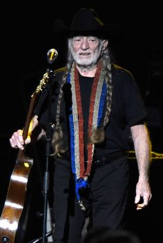 Willie Nelson Photos Photos - Singer Willie Nelson performs onstage at the 25th anniversary MusiCares 2015 Person Of The Year Gala honoring Bob Dylan at the Los Angeles Convention Center on February 6, 2015 in Los Angeles, California. The annual benefit raises critical funds for MusiCares' Emergency Financial Assistance and Addiction Recovery programs. - The 2015 MusiCares Person Of The Year Gala Honoring Bob Dylan - Show