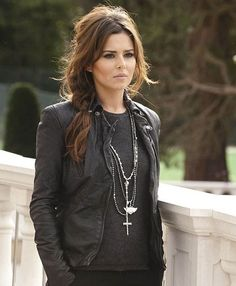 Fall Fashion Trends in Clothing & Jewelry- Black leather biker jacket accented with layered silver necklaces.