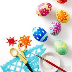Jazz up your Easter basket with these creative Easter egg dyeing and decorating ideas made with crafts supplies like tissue paper, lace trim, rubber bands, temporary tattoos and more.