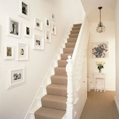 White walls and picture frames in Hallway | Decorating Ideas | Interiors | redonline.co.uk Ideas For Hallways, Stairs And Hallway Ideas, Hallway Pictures, Corridor Ideas, Redo Stairs, Pictures In Bathroom, White Staircase, White Hallway, White Banister