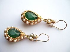 Indian Jewellery and Clothing: Distinct earrings..