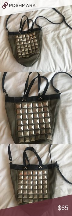 Free People studded purse One of my favorite bags, studded on both sides, with a star lining on the inside! Strap has a little wear and tear but overall great condition. Free People Bags Crossbody Bags