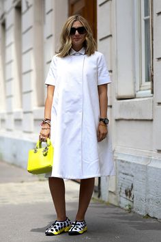 White midi dress with collar and a mini structured bag