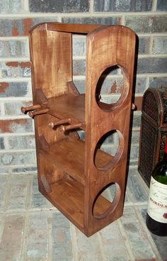 This lovely handmade wine caddy stores your wine bottles and 4 glasses in rustic style! Lovingly handmade from reclaimed wood and shaker pegs then