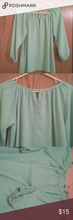 Top Beautiful green pastel colored silky blouse. Cut out in fron and back neck with fitted wrist that flow.  So pretty and feminine.  No size fits S To M. fransesca's Tops Blouses