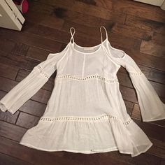 Very cute/casual top This top can be very casual and also casual/dressy. When I would wear it, I would usually wear it with jeans and wedges. It's in good condition. There is a very very small mascara stain on the bottom of the front of the top. Haute society Tops Blouses