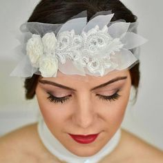 A beautiful and one of a kind flower headband, part of the timeless Autumn Leaves Collection, which would be amazing as a Gypsy wedding headband or wedding headpiece. It is also perfect for a boho chic bride having a very bohemian wedding. This delicate handtied boho headband is made with soft tulle onto which an intricate arrangement of ivory roses (fabric flowers) and leaves, lace and beads has been set. The tulle band is simply hand tied around the head with a knot and a bow, and can be…