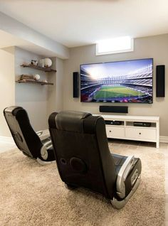 Serious TV and chairs for some serious gaming. Interior Design by Biondi Décor paula@biondidecor.ca