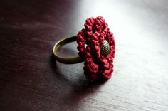 Deep wine red - tatted lace flower ring. $12.00, via Etsy.