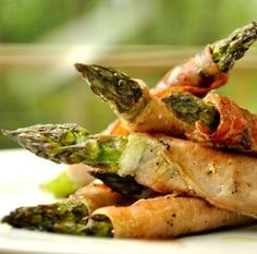 Take crescent roll, spread inside with cream cheese and wrap around asparagus,