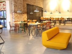 The Kitchen Rotterdam #cafe #design. Seating at tables and comfy couch.
