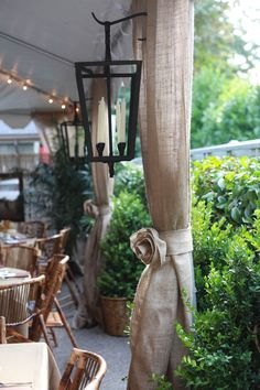 Havana Nights Decor...burlap drapes, tie backs with burlap roses, iron candle lamps, bamboo chairs...it's all about AMBIANCE.