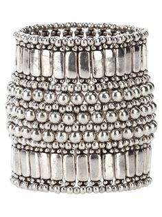 Metallic cuff from Philippe Audibert featuring a beaded trim and centre, larger rectangular metal detail on each end and a small coin emblem on the ridge.::Nice!