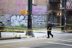Police investigate the scene in Brooklyn after Jerrol Harris, 37, was arrested for shooting a man an... - Provided by New York Daily News