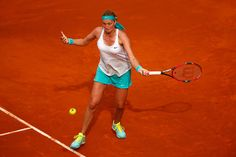 Petra Kvitova of Czech Republic in action against Svetlana Kuznetsova of Russia in the final during day eight of the Mutua Madrid Open tennis tournament at the Caja Magica on May 9, 2015 in Madrid, Spain