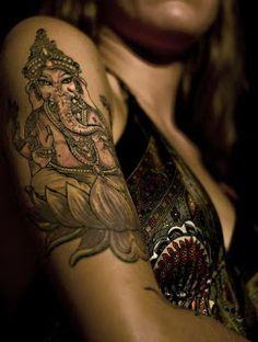Ganesha tattoo- the hindu God of overcoming obstacles, many meanings. I love this