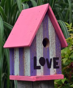 This house is purple, white , pink and features the word love cut out of recycled rusty metal. Has 1 1/4 hole for wrens and other songbirds.
