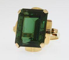 Lot, 671, An Art Deco style yellow gold rectangular cut tourmaline dress ring 17mm x 13mm, size M 1/2, est. £800-1000