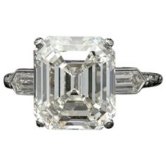 Hancocks 6.24 Carat Emerald Cut Diamond Ring With Bullet Diamond Shoulders  | From a unique collection of vintage engagement rings at https://www.1stdibs.com/jewelry/rings/engagement-rings/