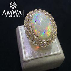 Opal can be so magically mesmerizing. تمتعي بروعة حجر الأوبال مع مجوهرات أمواج…