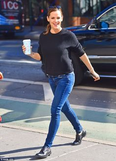 Lovely lady: Later on in the day, she dressed more comfortably as she changed into a black sweater with skinny blue jeans and black leather loafers