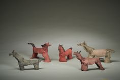 """""""The Herd"""" by Leslie Potter --- 2014; Clay, Acrylic paint; handformed with slab roller, cone six firing, painting; 11.5x21x4.5; 11x23x5.5; 10x16x3; 10x18x5; 10x16x4.5; Value: $1,375.00; For Sale"""